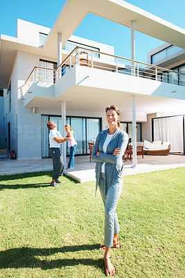 Buy stock photo Full length of beautiful woman standing in front of her house with husband and daughter in background