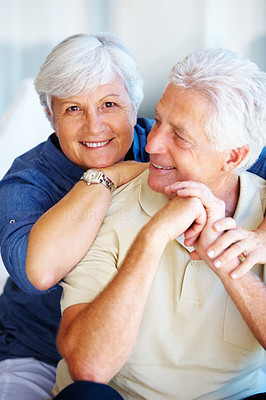 Buy stock photo Portrait of woman embracing man from behind and smiling