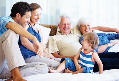 Buy stock photo Family sitting together on a sofa and having fun