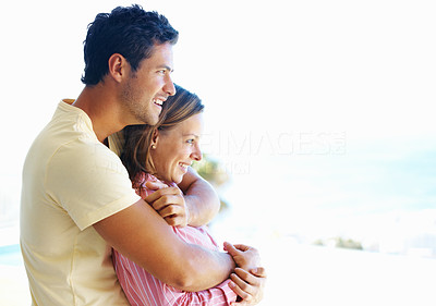 Buy stock photo Side view of man embracing woman from behind and looking at copyspace