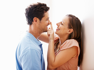 Buy stock photo Couple having a moment while woman touching man's nose