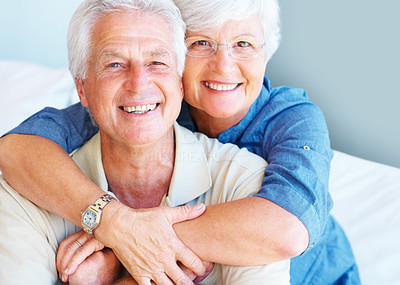 Buy stock photo Happy senior couple smiling with woman embracing man from behind