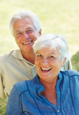 Buy stock photo Closeup portrait of senior woman sitting on grass with man and smiling