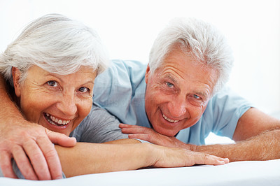 Buy stock photo Closeup portrait of senior couple relaxing in bed and smiling