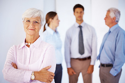 Buy stock photo Portrait of beautiful old woman with arms folded and group of people in background