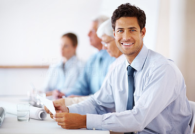 Buy stock photo Confident young business man attending a meeting with his colleagues