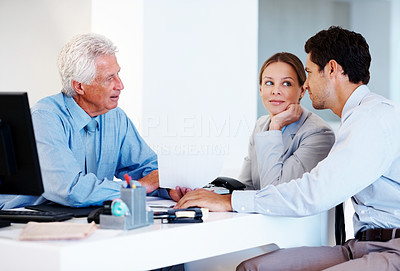 Buy stock photo Portrait of a old advisor consulting a smart young couple at office