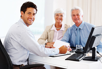 Buy stock photo Portrait of a happy professional financial consultant during meeting  with senior couple