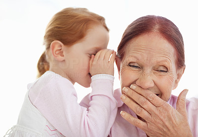 Buy stock photo Portrait of sweet girl telling a secret to her grandmother