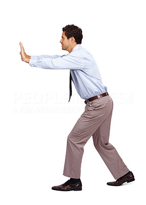 Buy stock photo Young business man pushing something isolated over a white background