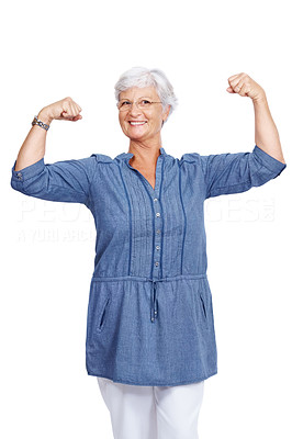 Buy stock photo Portrait of a happy old woman showing her muscles isolated over white background