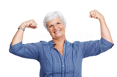 Buy stock photo Portrait of a fit old woman flexing her arms and showing her muscles against white background