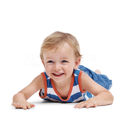 Buy stock photo Portrait of a cute little adorable child lying on floor over white background