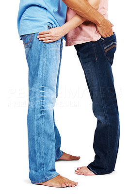 Buy stock photo Lower section image of young couple standing together isolated against white background