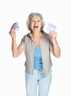 Buy stock photo Portrait of a cheerful senior female holding cash in hands on white background