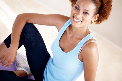 Buy stock photo Portrait of a cute young lady exercise on yoga mat and smiling