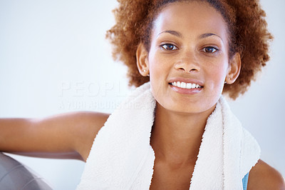 Buy stock photo Closeup portrait of a beautiful young woman with towel around her neck holding a fitness ball