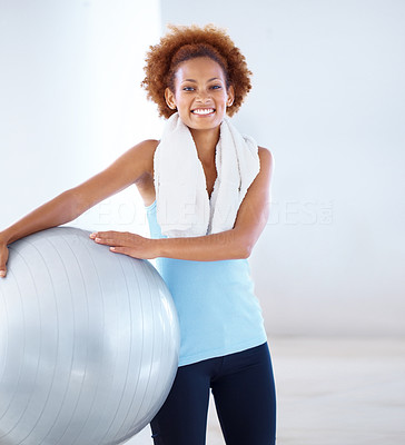 Buy stock photo Portrait of a beautiful woman at gym holding pilates ball and smiling at you next to copyspace