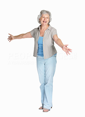 Buy stock photo Full length of a cheerful mature woman standing isolated against white background