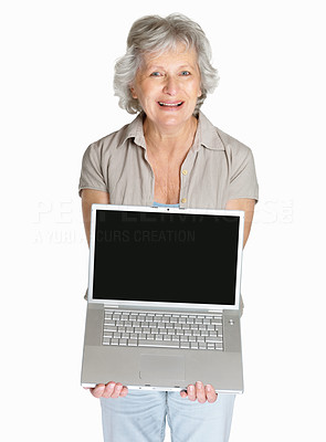 Buy stock photo Portrait of a happy mature woman displaying laptop isolated against white