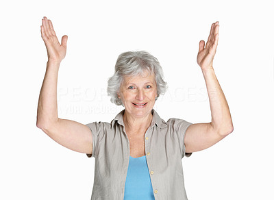 Buy stock photo Portrait of a happy mature woman with her hands raise isolated against white