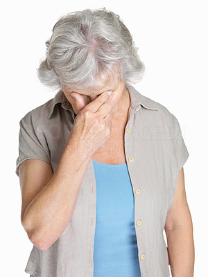 Buy stock photo Portrait of a senior woman holding her head in pain isolated against white