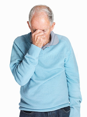 Buy stock photo Portrait of a sad mature man holding his head isolated against white