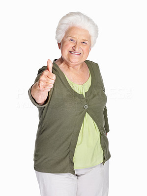 Buy stock photo Portrait of a happy elderly woman showing thumbs up sign isolated against white