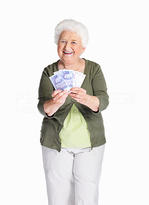 Buy stock photo Portrait of a happy elderly woman holding dollars isolated against white