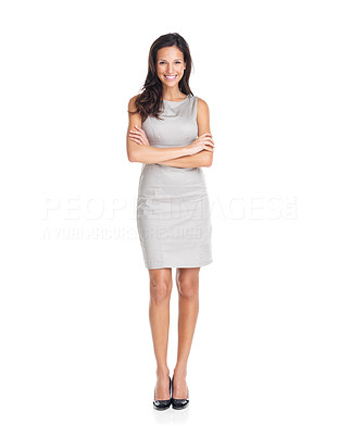 Buy stock photo Portrait of a happy young woman standing with folded hands on white background