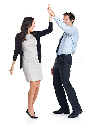Buy stock photo Young business colleagues giving each other a high five isolated on white background