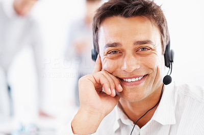 Buy stock photo Closeup of handsome business man wearing headset with colleagues in background