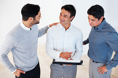 Buy stock photo Happy business man showing document to his colleagues