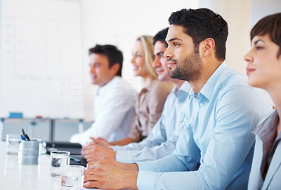 Buy stock photo Business man with his colleagues listening to presentation in conference room