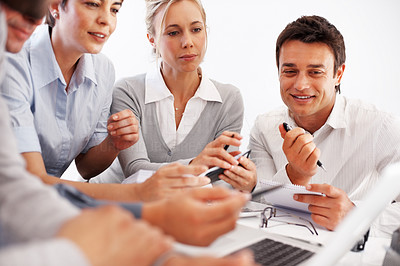 Buy stock photo Group of business people discussing work on laptop during meeting