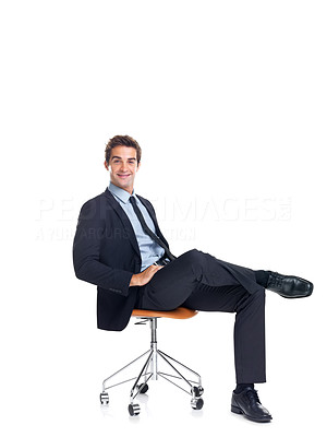 Buy stock photo Confident young businessman sitting on chair on white background