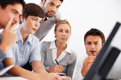 Buy stock photo Group of business people concentrating on computer screen during meeting