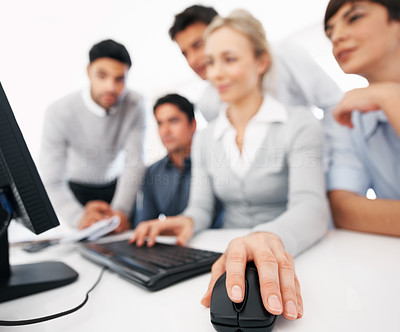 Buy stock photo Focus on business woman's hand using computer mouse during corporate meeting