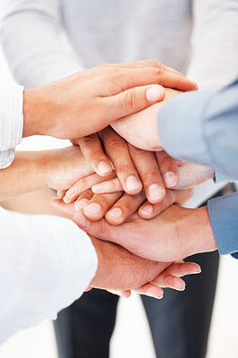 Buy stock photo Cropped image of business people with their hands piled on each other