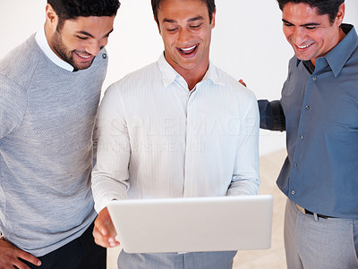 Buy stock photo Happy business man with his colleagues working together on laptop