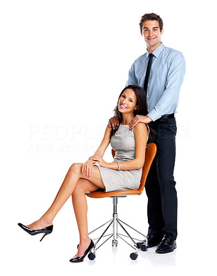 Buy stock photo Happy young businessman standing with woman sitting on chair against white background