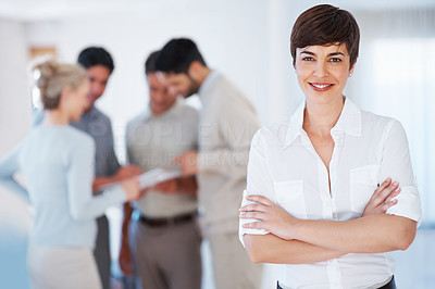 Buy stock photo Business woman with hands folded and colleagues discussing in background