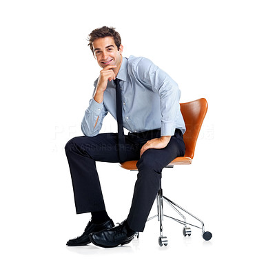 Buy stock photo Portrait of smart young male executive sitting on chair isolated against white background