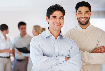 Buy stock photo Confident business men with hands folded and colleagues discussing in background