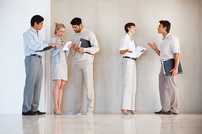 Buy stock photo Full length of business team having conversation with each other