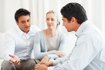 Buy stock photo Couple in discussion with business consultant