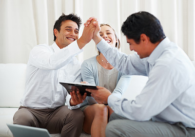 Buy stock photo Couple with the man and consultant holding hands and celebrating