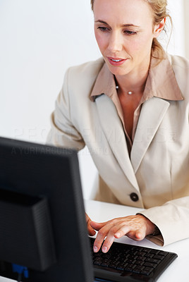 Buy stock photo Pretty business woman working on computer