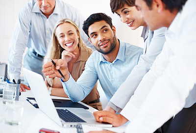 Buy stock photo Business man sitting at table and discussing project with colleagues on laptop
