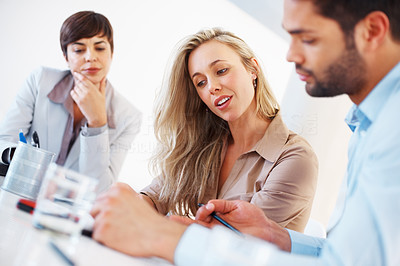Buy stock photo Colleagues discussing during meeting with focus on beautiful female executive